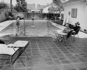 "Photograph caption dated September 30, 1961 reads, ""Typical of the relaxed outdoor living in the San Fernando Valley is this scene around the backyard swimming pool. Children enjoy the fun under watchful eye of grownups. Thousands of these relaxation spots dot the Valley and more are being built each year."" order# 00082908"