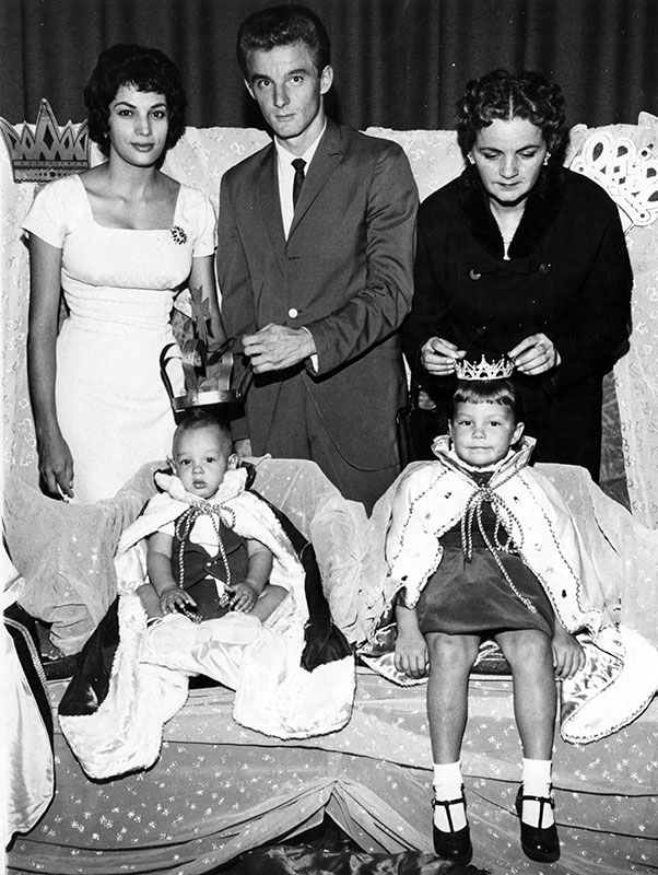 """Happy Burbank parents pose with winners over Burbank VFW Baby King and Queen Show. Mr. and Mrs. David Botkiewicz, left, 234 S. Frederick St., beam over son David, 10 months, who was chosen king. Mrs. C. M. Rogers, right, 2433 N. Avon St., is proud mother of newly crowned queen, Lisa, 4. Coronation ceremonies in Olive Recreation Center, 1111 Olive Ave., were attended by more than 2,000.""  Order #00109354"