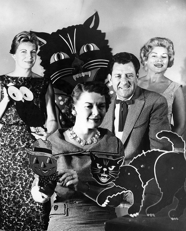 """Preview of special entertainment planned for Toluca Lake School PTA fall festival on Saturday is previewed by, left to right, Mrs. Keith Jones, chairman; Mrs. Burton Jay, first vice president; Doye O'Dell, guest star, and Mrs. Jocelyn Ryan, president."" October 20, 1958. Order #00115098"