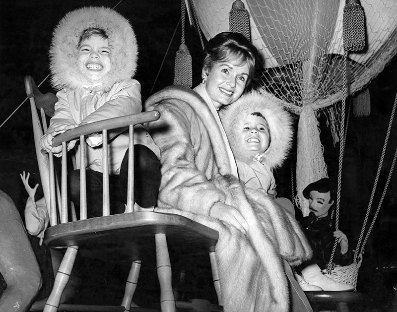 December 2, 1961 Actress Debbie Reynolds and her two children, Todd and Carrie, on the 'Mysterious Island Float' during Magnolia Park's annual Christmas Parade, photo by Jeff Goldwater