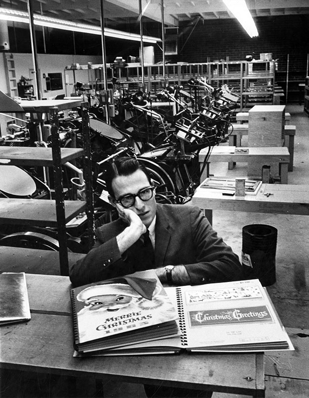 "Article from December 30, 1963 partially reads, ""'It's all over now,' said sales manager Lou Weintraub, 26, as he strolled among some 35 idle presses at the Mission Card Co., Canoga Park. The big room echoed with his footsteps, as he explained that less than a month ago, these presses and some 100 workers bustled with activity. Now only management personnel and a skeleton crew of about 10 show up for work at the modern plant at 20235 Bahama St. This situation takes place every year at Mission - a company which deals in Christmas cards."" Photo by George Brich"